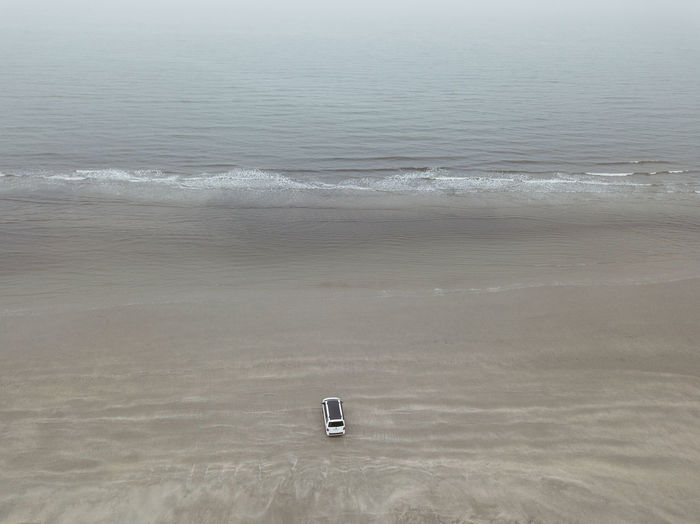 Aquatic Sport Beach Beauty In Nature Day High Angle View Land Motion Nature No People Non-urban Scene Outdoors Scenics - Nature Sea Sport Tranquil Scene Tranquility Water Wave