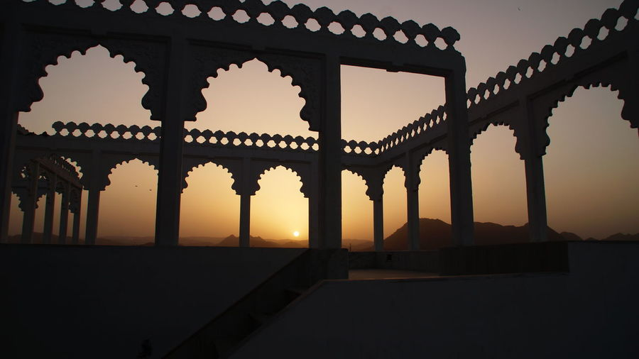 Arch Architectural Column Architecture Building Exterior Built Structure Column Dusk In A Row Nature Orange Color Outdoors Photo Photography Scenics Sea Silhouette Sky Sunlight Sunset Sunset_collection Sunsetporn Sunsets Tranquility Travel Destinations Water