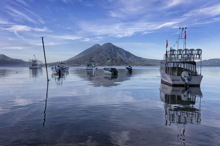 Atitlan lake boats and volcanos Guatemala Beauty In Nature Cloud - Sky Day Lake Mountain Nature Nautical Vessel No People Outdoors Reflection Scenics Sea Sky Tranquil Scene Tranquility Water