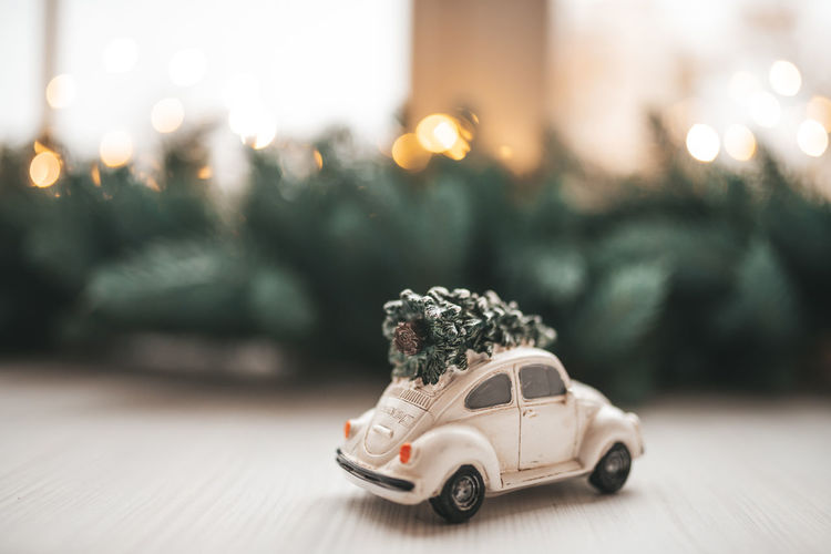 Toy car on illuminated christmas tree
