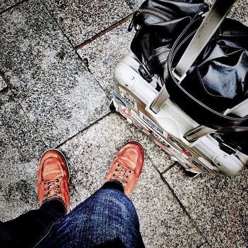 Travel Low Section Human Leg Human Body Part Body Part Shoe Real People High Angle View Standing Personal Perspective Lifestyles Men People Sunlight Day Human Foot Human Limb City Street Outdoors Nature