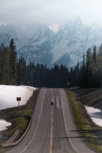 Mountain Road Mountain Range Cold Temperature Scenics The Way Forward Snow Nature Transportation Outdoors Day Winter Tranquil Scene Tranquility Beauty In Nature Landscape Sky Tree No People Skateboarding