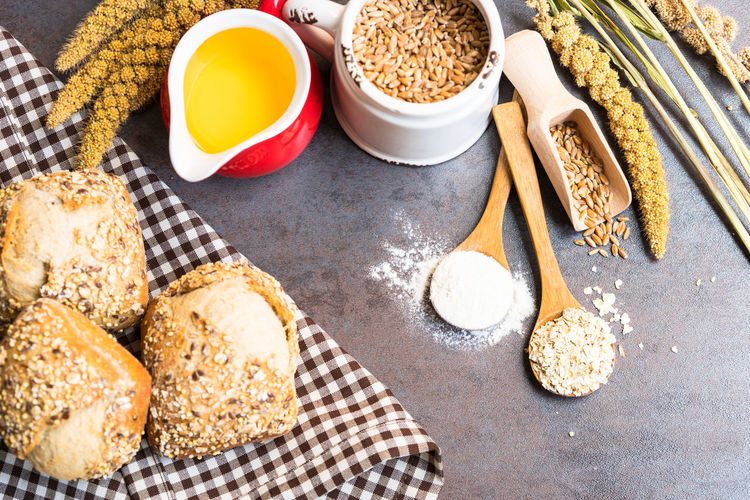 wholegrain bread and ingredients for bread preparation Bakery Baking Bread Cat Close-up Composition Food Food And Drink Grains Healthy Eating Indoors  Loaf Nature Nature_collection Oil Spatula Still Life Table Wheat
