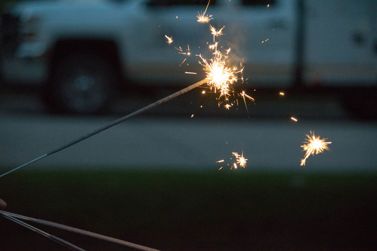 Close-Up Of Lit Sparklers At Night
