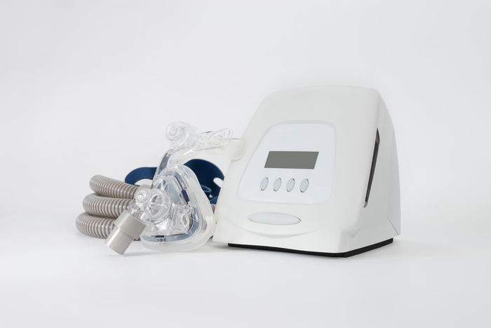 Full components of Cpap machine on white background,selective focus. Cpap Continuous positive airway pressure system includes of main unit,mask,tube and headgear,healthcare concept. Sleep Apnea Cleaning Equipment Disorder Filter Medical Equipment Snoring Tube Cpap Cushion Mask Nasal Obstructive Sleep Apnea