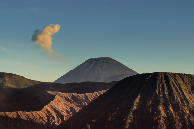 View of volcanic mountain against sky.  sunset in bromo tengger semeru.