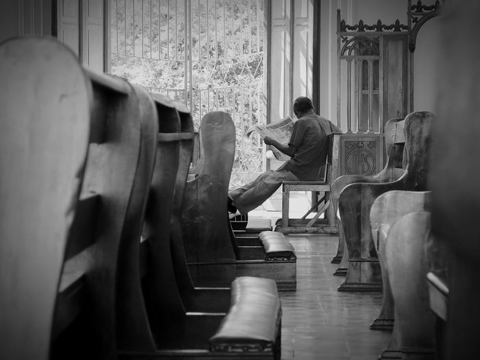 reading the paper at church Monochrome Blackandwhite EyeEm Best Shots - Black + White Black And White Church Simplicity Hanging Out EyeEm Best Shots Eye4photography  Urban Streetphotography Travel Photography Travel Newspaper Perspective The Street Photographer - 2016 EyeEm Awards This Is Masculinity