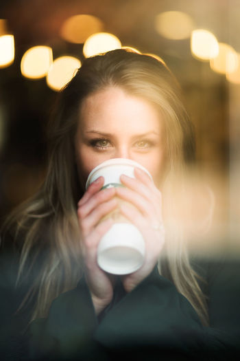 Coffee Shop Beautiful Woman Close-up Coffe Coffee - Drink Coffee Cup Cup Day Drink Drinking Food And Drink Freshness Front View Indoors  Leisure Activity Lifestyles Looking At Camera One Person Portrait Real People Refreshment Through The Window Women Young Adult Young Women