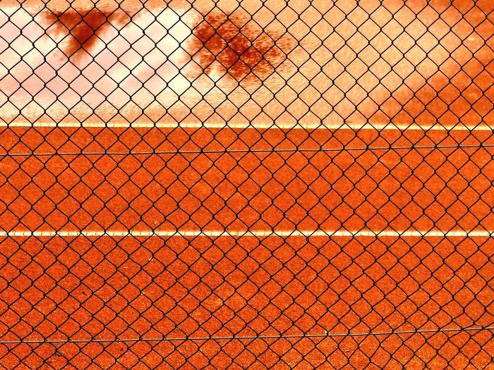 Running track seen through chainlink fence
