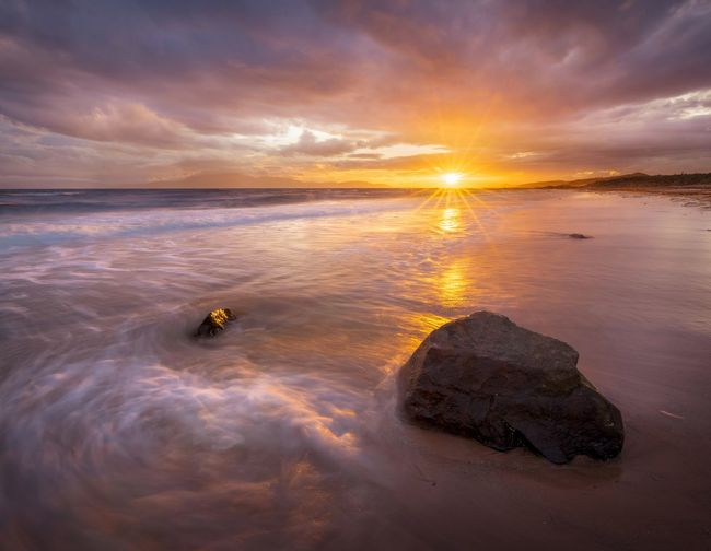 Seaside sunset Sunset Reflection Sea Outdoors Sky Beach Nikon Scotland Dramatic Sky Water Nature Beauty In Nature Tranquility No People Scenics Horizon Over Water Day