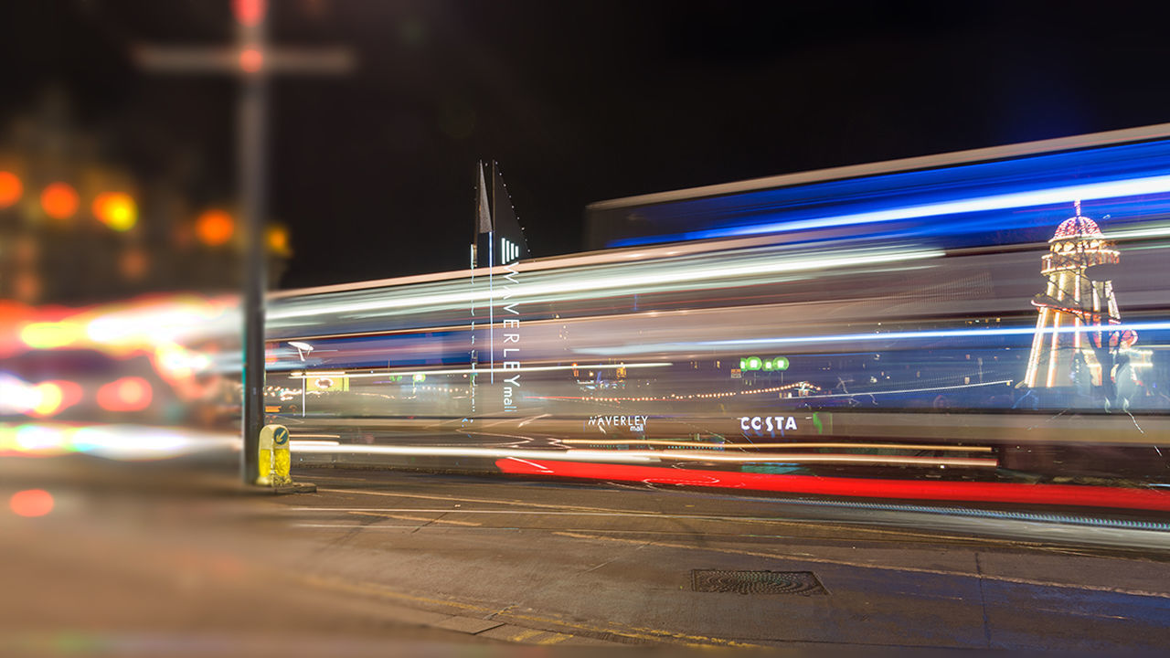 illuminated, night, speed, transportation, blurred motion, public transportation, light trail, motion, mode of transport, long exposure, train - vehicle, outdoors, no people, building exterior, architecture, high street, city