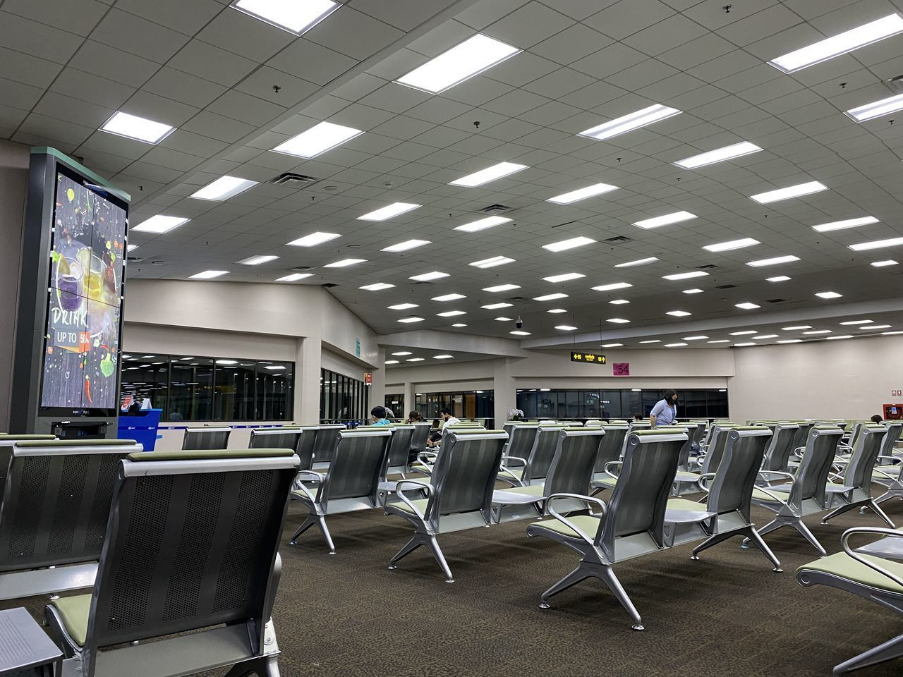 EMPTY CHAIRS AND TABLE IN AIRPORT