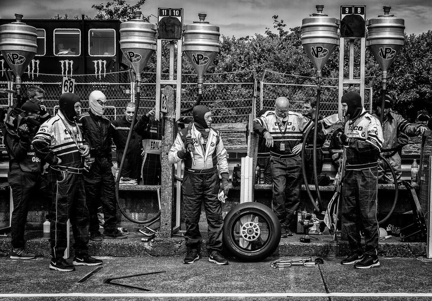 Ian Hutchinson's Pit Crew await his arrival for the first pit stop of RST Superbike TT, Saturday 4th June 2016 Black And White Crew IAN Hutchinson Isle Of Man TT Mode Of Transport Motorbike Motorbikes Motorcycle Motorcycles Motorsport Pit Pit Crew PitCrew Pitstop Road Race Road Racing Spare Wheel Transportation