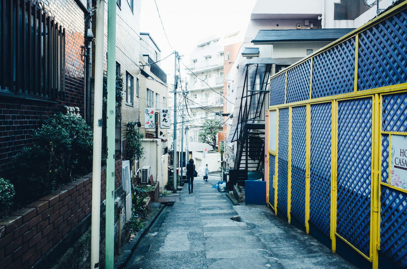 Backstreets & Alleyways Daytime Japan Japan Lovers Japanese Culture Looking Into The Future Morning Rear View Shibuyascapes TOKYO TOKYO Old Meets New The Changing City Tokyo Woman Alley Architecture Building Exterior Built Structure City Day Men One Person Outdoors People Real People The Way Forward Tranquil Scene Water Women Around The World Mobility In Mega Cities Colour Your Horizn