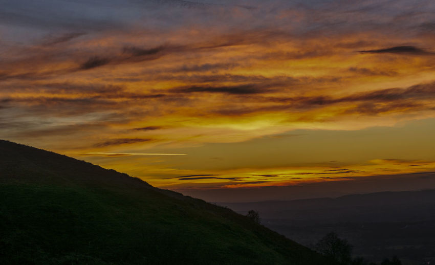 Vivid sunset Malvern Hills Sunset_collection Awe Beauty In Nature Cloud - Sky Dramatic Sky Environment Idyllic Landscape Mountain Mountain Range Nature No People Non-urban Scene Orange Color Outdoors Scenics - Nature Silhouette Sky Sunset Tranquil Scene Tranquility