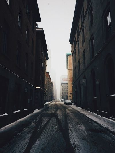 Low angle view of city during winter
