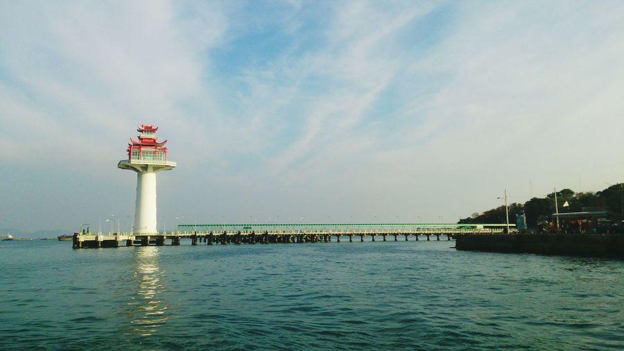 Tower in sea at ko sichang against sky