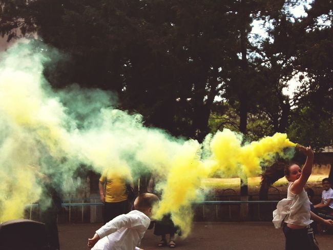 Smoke - Physical Structure People Leisure Activity Adults Only Real People Colorsplash Color Day Adult Togetherness Outdoors Tree Only Men Holi Powder Paint