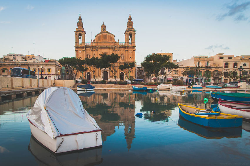 Boats in front of Parish Church in Malta. Boat Boats Boats⛵️ Built Structure Canonphotography Church City Cityscapes Island Islandlife Malta Mediterranean  Outdoor Photography Sky Wanderlust Water Waterfront
