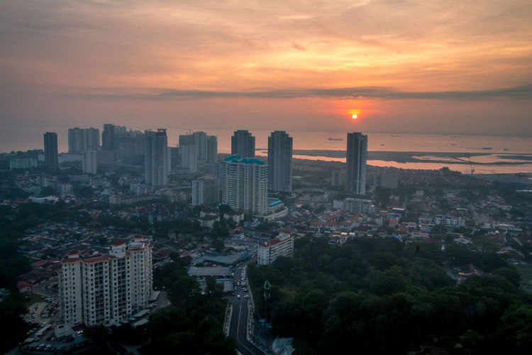 Sunrise at Penang island, Malaysia. Architecture Building Building Exterior Built Structure City Cityscape Cloud - Sky Crowd Crowded Financial District  High Angle View Modern Nature Office Building Exterior Orange Color Outdoors Residential District Romantic Sky Sky Skyscraper Sun Sunset Tall - High Urban Skyline