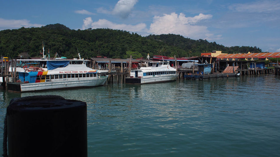 Pangkor Island Jetty, The main entrance to this island tour Ferry Islands Ocean View Pangkor Island Tree Blue Blue Sky Boat Day Harbor Island Jetty Jetty View Malaysia Nature No People Outdoor Outdoor Photography Outdoors Sea Sky Tourism Transportation Water Waterfront