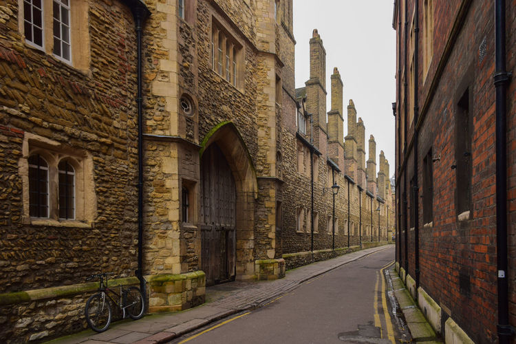 Alley amidst historic buildings in city