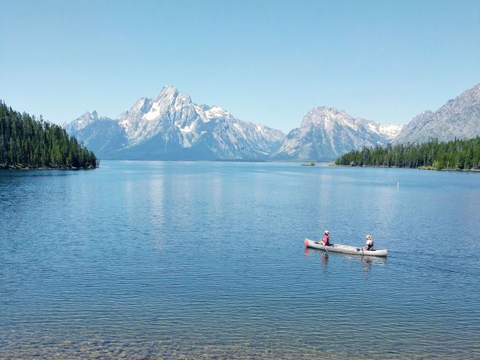 Canoe Water Mountain Oar Full Length Tree Lake Sitting Men Snow Snowcapped Mountain Mountain Range Rocky Mountains