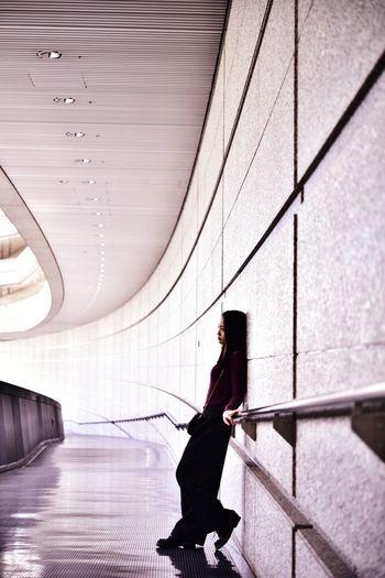 Side view of woman walking in corridor