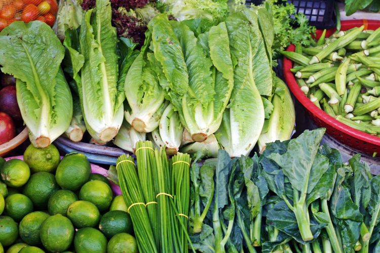 High angle view of fresh vegetables arranged in market for sale