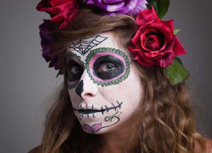 Close-Up Of Woman With Spooky Face Paint At Home During Halloween
