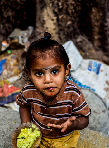 InnocenceLooking At Camera Front View One Person Child People Portrait Day Close-up Outdoors Streetphotography Kids Portrait Inocence  Sunlight Indian Street Photography