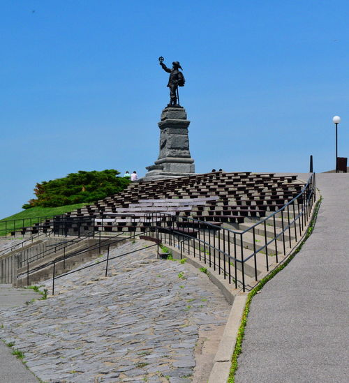 A statue at the top of a hill