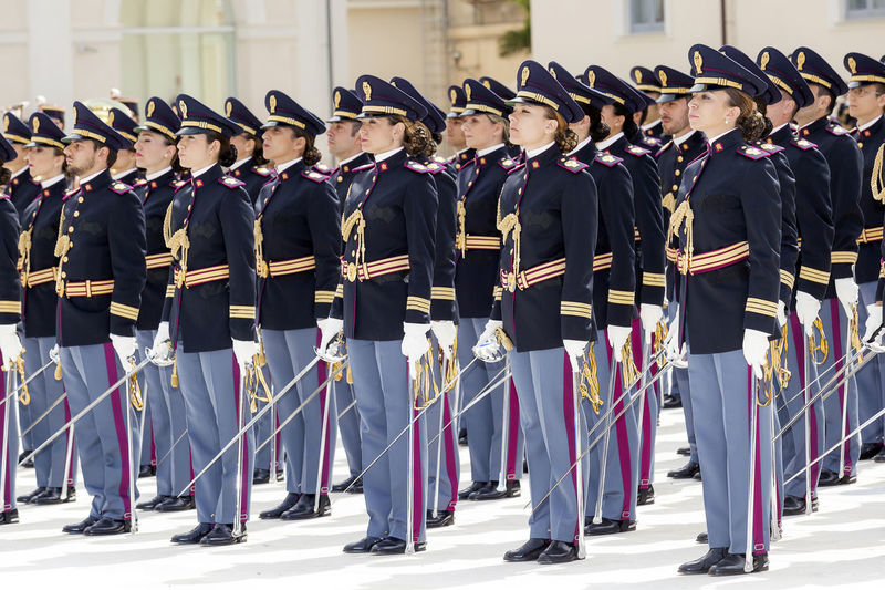 Rome, Italy - May 25, 2016: Men and women of the police in full uniform during the celebrations for the 164th anniversary of the State Police - deployment. Anniversary Cadets Celebration Deployment Uniform  Group Of People Men And Women Parade Police Officers Swords Uniforms Camp