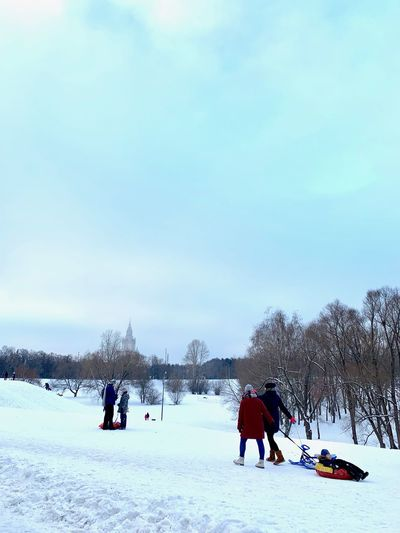Cold Temperature Snow Winter Real People Group Of People Sport Leisure Activity Field Lifestyles Winter Sport Nature Beauty In Nature Sky Tree Day Land Men Scenics - Nature Vacations Warm Clothing Outdoors Russian Winter Winter Activities Moscow Life Moscow