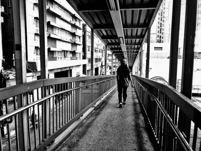 Railing Full Length Architecture Built Structure Men Rear View City Walking Casual Clothing City Life Day Well-dressed Office Building Elevated Walkway The Way Forward Pedestrian Walkway Black And White Photography Black & White HongKong Hong Kong Blackandwhite Stories From The City