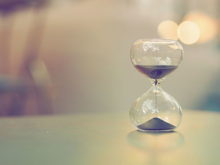 Hourglass on table with copy space. Business Copy Space Close-up Day Focus On Foreground Hourglass Hourglasse Indoors  No People Sand Table Time Vintage