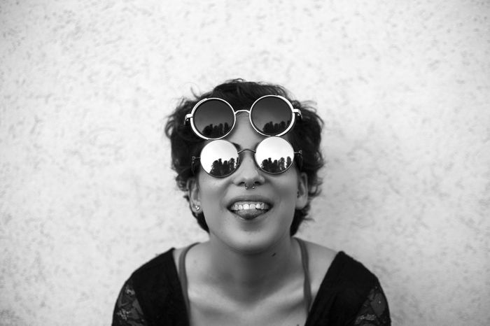 EyeEm Selects People One Person Beautiful Woman Day Funny Faces Sunglasses Piercing Tounge Out  Fashion Style