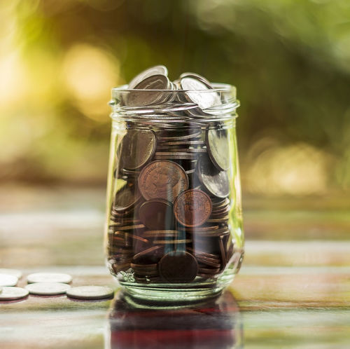 Coin in bottle Accountancy Growing Growth Account Accountant Accounting Bank Banking Bottle Coin Earnings Finance Financial Invest Investing Investor Jar Money Save Savings Wealth