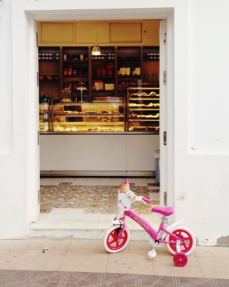 Pink Toys Small Bike In Front Of A Shop Tarifa Showcase: February Childrens Toys Bakery Ladyphotographerofthemonth
