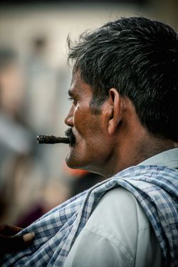 Gangs of Wassepur lll Smoking Smoking Issues Beedi Ciggarette Portrait Photography Portrait Of A Man  Portraits Of EyeEm Jawline Streetphotography Street Jaw_dropping_shots EyeEm Selects Mustache Cigar Streetphoto Men Headshot Portrait Profile View Side View Close-up Head And Shoulders One Mature Man Only