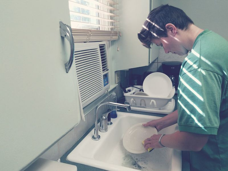 Doing the dinner dishes at the cottage. Queer Women Washing Dishes Sink Chores Soap Bubbles Cottage Vacation Simple Old Fashion Woman Lgbt Gay Lesbian Light And Shadow Kitchen Cabin Idaho Samsung