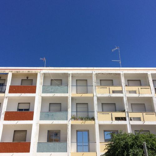 2017 Architecture Building Exterior Blue Sky Red Blue Yellow Architecture_collection Architecturephotography Architectural Column Architectural Feature Balkony Balkony View Window Outdoors Day Clear Sky No People Low Angle View Residential Building Sky Colourful Algarve