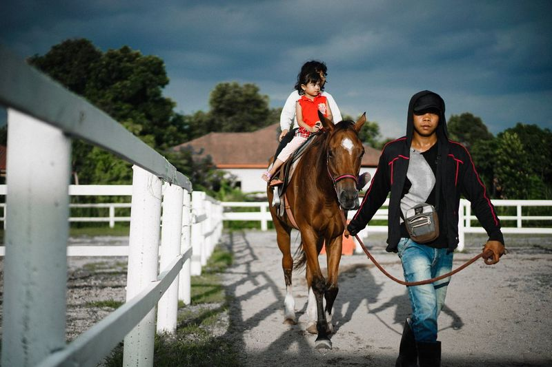 Take a ride.. kiddo.. 🐎 Horse One Animal Girls Horseback Riding Sky Two People Riding Cloud - Sky Mammal Domestic Animals Leisure Activity Outdoors Animal Themes Lifestyles Real People Happiness Bonding Day Child Smiling