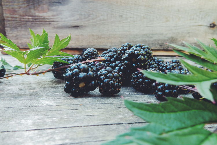 Close-up of blackberries on wood