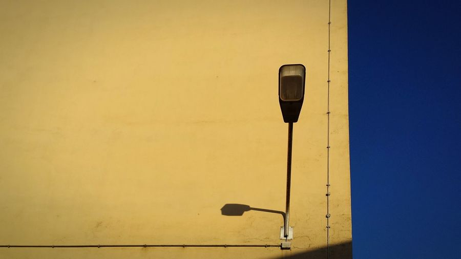 Close-up of yellow lamp against clear sky