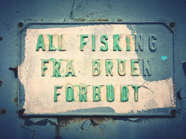 'All fishing from the bridge forbidden' Rustic Norway Huawei Norwegian Funny 60's Bridge Detail EyeEm Selects Communication Text Textured  Warning Sign Capital Letter Western Script Close-up