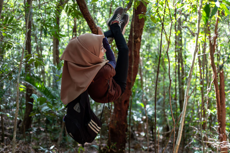 Langkawi Forest Tree Plant Land One Person Leisure Activity Real People Men Day Nature WoodLand Growth Lifestyles Adventure Outdoors Full Length Casual Clothing Holding Focus On Foreground
