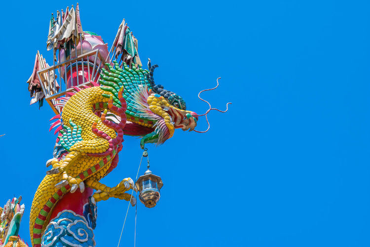 Animal Representation Art And Craft Blue Chinese Dragon Clear Sky Copy Space Craft Creativity Day Dragon Festival Low Angle View Multi Colored Nature No People Ornate Outdoors Representation Sculpture Sky Statue