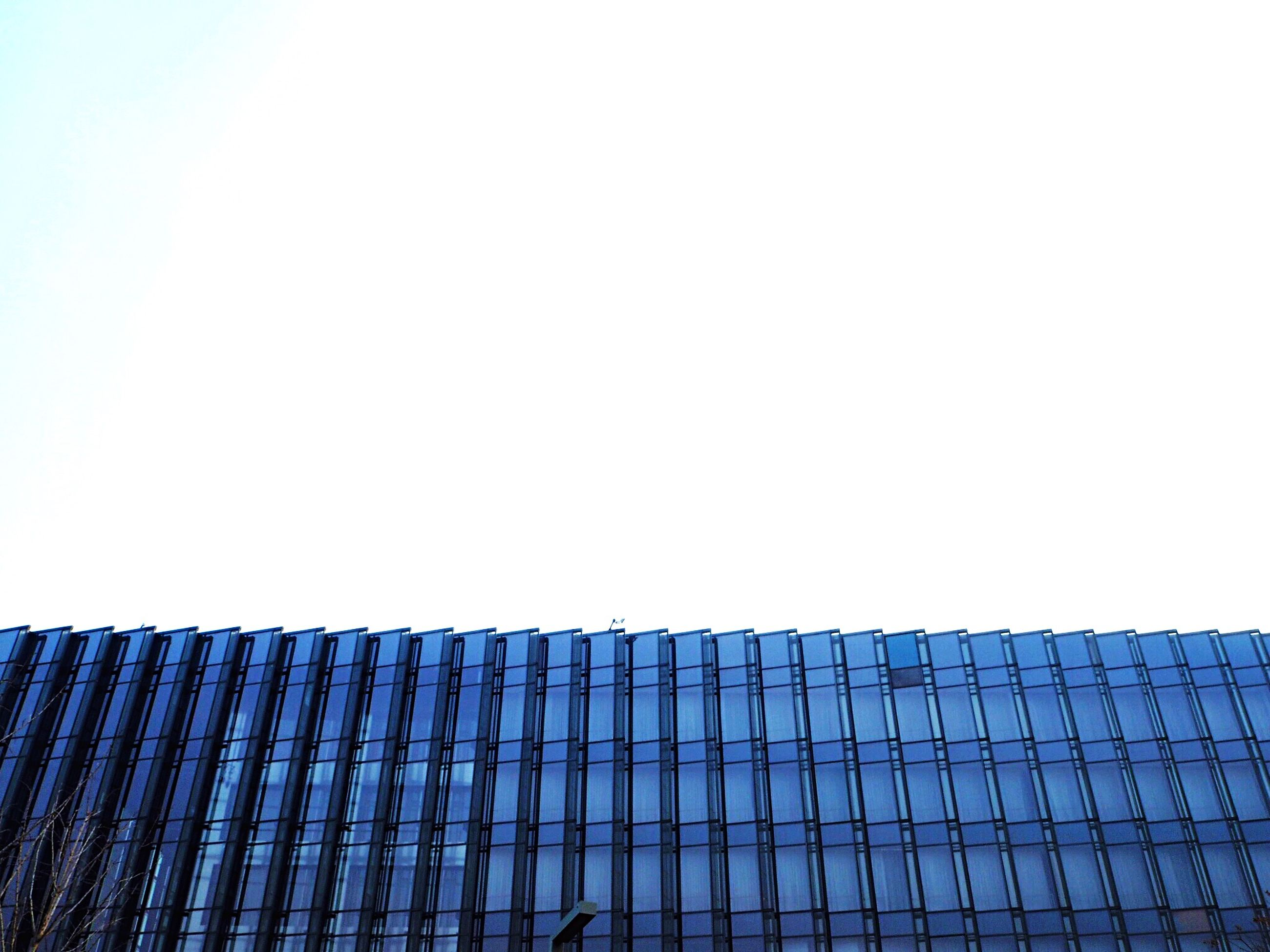 architecture, built structure, low angle view, building exterior, clear sky, copy space, modern, pattern, office building, city, building, tall - high, sky, skyscraper, day, outdoors, blue, no people, tower, repetition