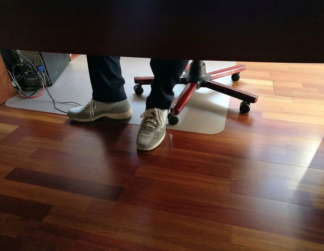 Day Hardwood Floor High Angle View Human Leg Indoors  Low Section Men Office Out Of The Box People Real People Shoe Standing Swivel Armchair Swivel Chair Two People Wooden Floor